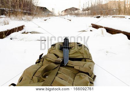 Tactical knif on sand back pack. Military