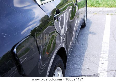Car body and doors damaged in a collision