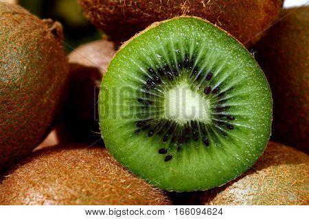 Kiwi fruit on cutting board - gree, raw kiwi