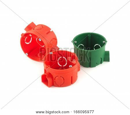 Color plastic containers for electric wire mounting isolated on white closeup