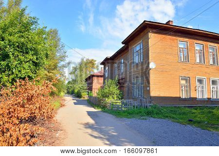 Street with old wooden building in the central part of Vologda Russia.