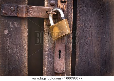 Close Up View Of A Padlock And Old Wooden Door