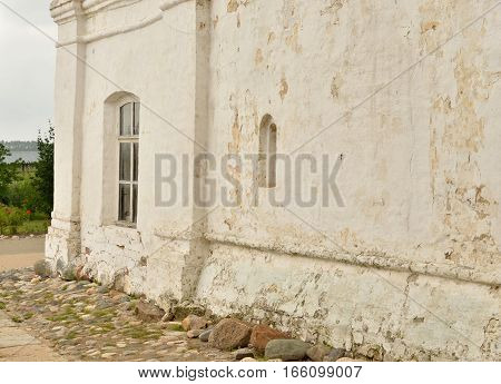 Fragment of old building in Saviour Priluki Monastery by cloud day near Vologda Russia.
