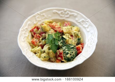 Healthy Vegetable Cucumber Pepper Broccoli Salad With Mayonnaise Sauce In White Plate