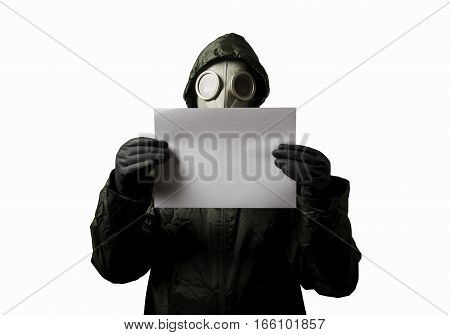 Man wearing a gas mask on his face and holding white paper on white background.
