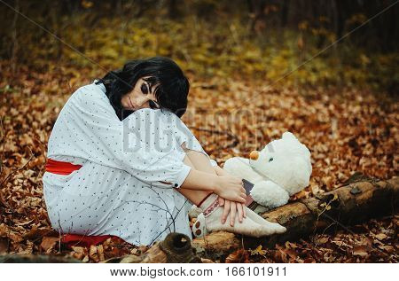 Young Sad Lonely Brunette Girl At Sleepwear Sitting And Being Taken On Knees