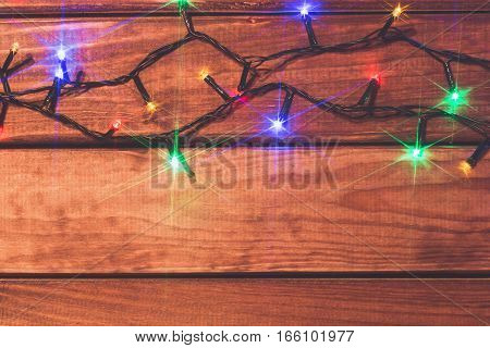 Valentines or christmas romantic lights on wood background with copy space.