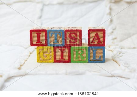 Wooden Alphabet Blocks On Quilt Spelling Its A Girl