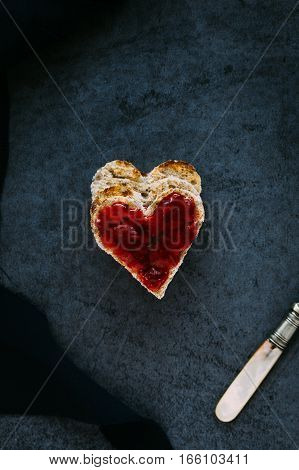 Heart Shaped Toast with Strawberry Jam on Black Slate