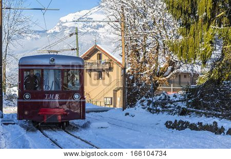 Saint-Gervais France - December 302014: TheTramway du Mont Blanc reaches the railway station in Saint Gervais on 30 December 2014. This is the highest tram in France connecting Saint Gervais with Nid d'Aigle station at the Bionnassay glacier.