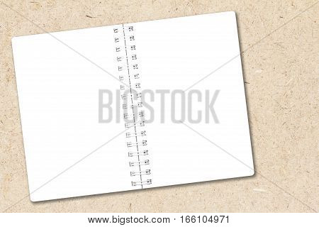 Open notebook paper on chipboard background for design with copy space for text or image.