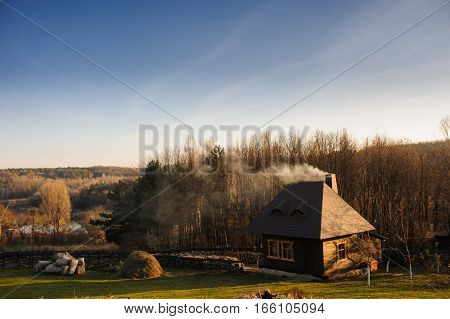 Wooden mountain house built from wood logs on sunny day in the forest blue sky