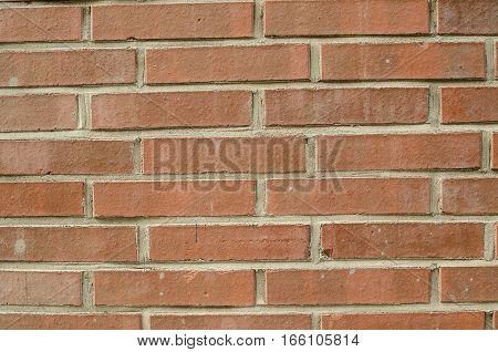 Focused texture of orange solid brick wall