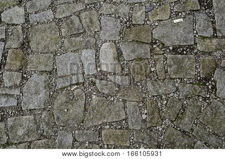 Focused texture of stone floor with dirt around