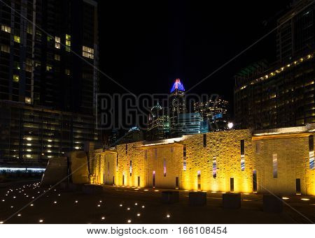 The wall at Romare Bearden park lit up at night in uptown Charlotte, North Carolina