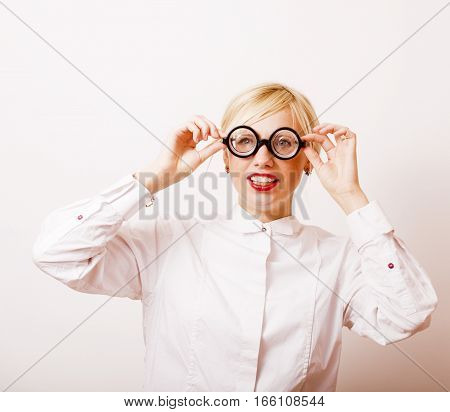bookworm, cute young blond woman in glasses, blond hair, teenage goofy, lifestyle people concept close up