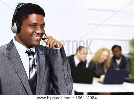 the employee call center in the background of the office