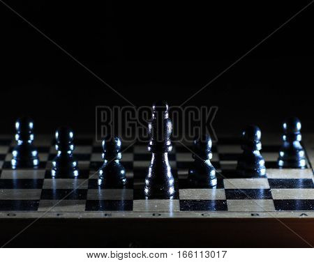 success concept in business - a chess composition with the figure of the leader is found.the photo has a empty space for your text