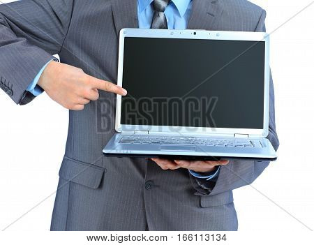The young businessman keeps the laptop. Isolated on a white background.