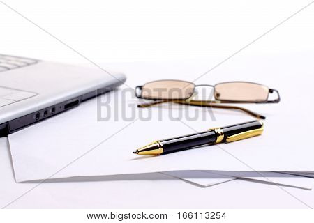 documents,glasses,pen and notebook at the workplace of the businessman.the photo has a empty space for your text