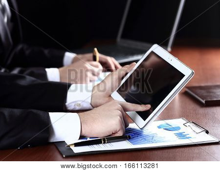 business team working with financial data on the tablet