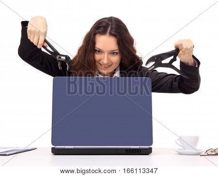 Young woman about to break the computer. A part of the office rage series.