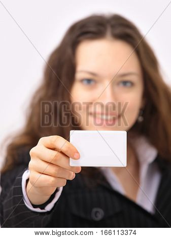 business woman holds out an empty badge with place for your text
