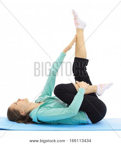 young woman performs fitness exercise sports Mat