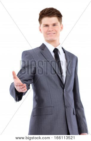 Confident business man giving you a hand shake on white background