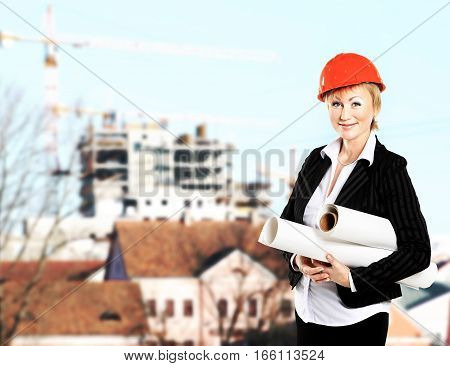 successful woman architect-designer with the project on the background of the object under construction.the photo has a empty space for your text