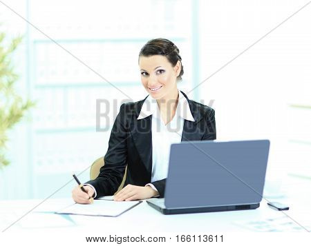 Beautiful businesswoman fills the plan of work in the office..photo has a empty space for your text