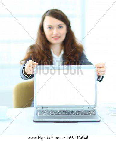 young woman showing a laptop with blank screen.the photo has a empty space for your text