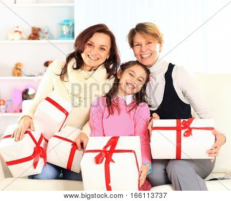 happy family with gifts for her birthday.