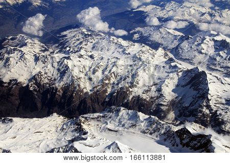 Birds eye view on mountains covered by snow