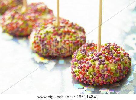 meringue on a stick sprinkling colored dessert sweets
