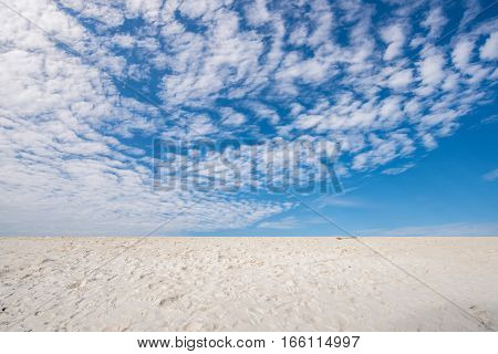 The scenery view of sky and white sand beach in summer season.