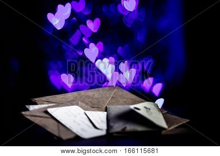 Valentines day letters, cards, glowing purple hearts in the dark
