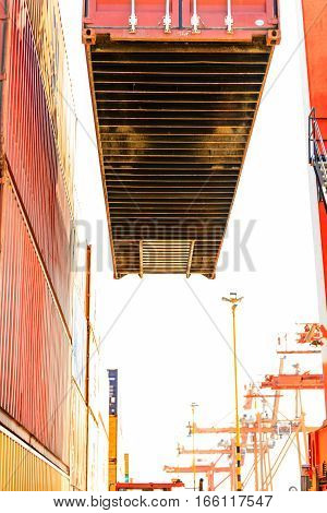 Commerce cargo shipping maritime industry concept. Containers transported by crane. Industrial equipment in harbour transporting goods.