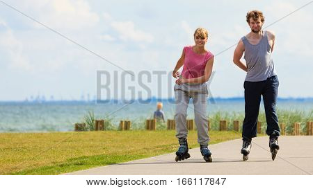 Teen Couple Together On Skates.