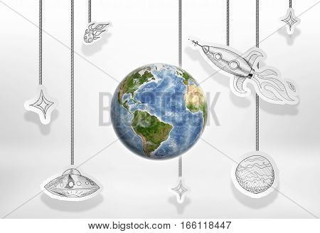 Planet Earth with painted satellites, rockets and comets. Earth and seeing grass and green plant. Environment and ecology. Ecological concept. Elements of this image are furnished by NASA.