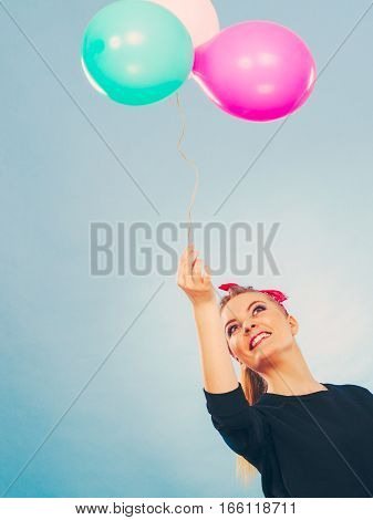 Lovely Smiling Girl Holds Colorful Balloons.