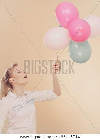 Joyful Girl Playing With Colorful Balloons