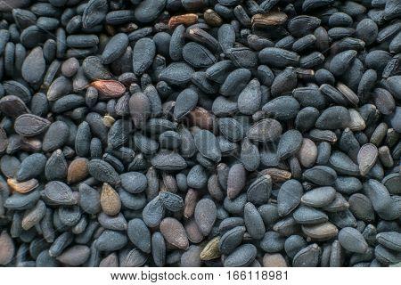 Black sesame seeds. Healthy sesame seeds on wooden table