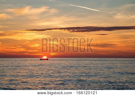 Fishing Boat On The Background Of Incredible Golden Sunrise, Clouds And Rising Sun.