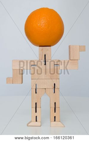 Wooden Robot Toy with orange on head at white