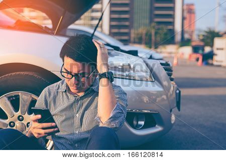 Young Asian Handsome Man Sitting By The Broken Down Car