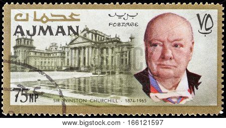 AJMAN - CIRCA 1966 : Cancelled postage stamp printed by Ajman, that shows Winston Churchill and Blenheim palace.