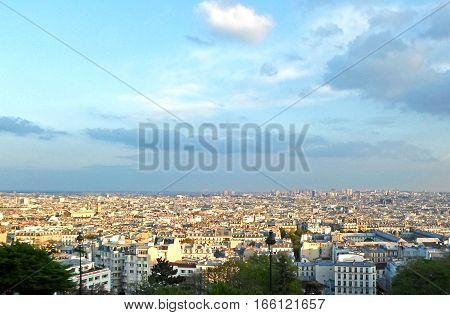 View of Paris from Montmartre hill in a sunny day, France