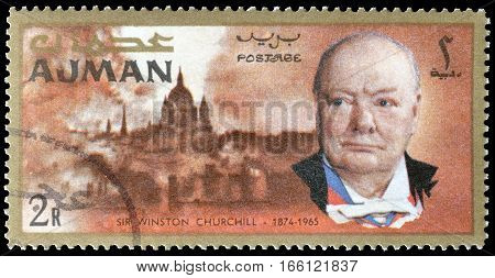 AJMAN - CIRCA 1966 : Cancelled postage stamp printed by Ajman, that shows Winston Churchill and London.