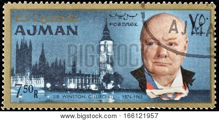 AJMAN - CIRCA 1966 : Cancelled postage stamp printed by Ajman, that shows Winston Churchill and Parliament.